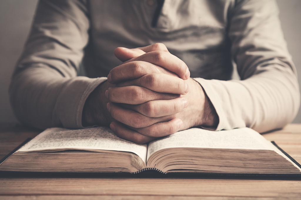 Praying With Bible Open